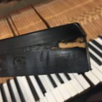 photo of piano key showing Damage from years of use