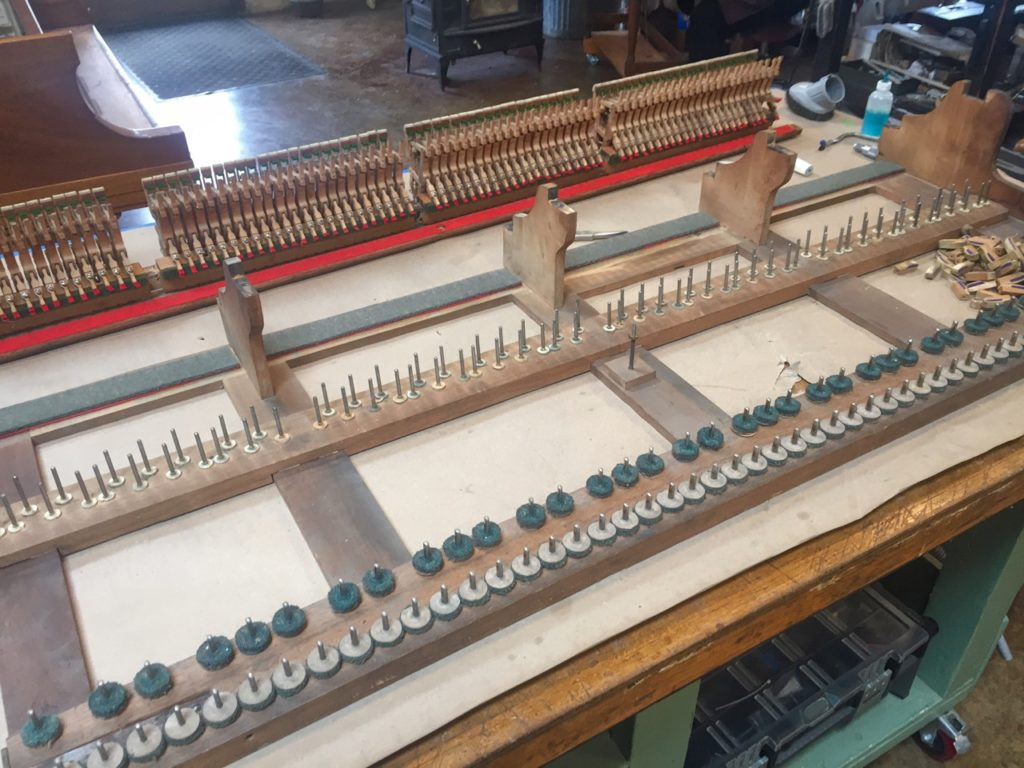 photo of a bare piano keybed