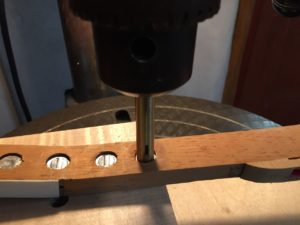 photo of A drill press jig swedges the lead . . .