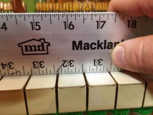 photo of Checking for key height with a straight edge