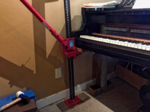 photo showing the tight fit jacking the piano